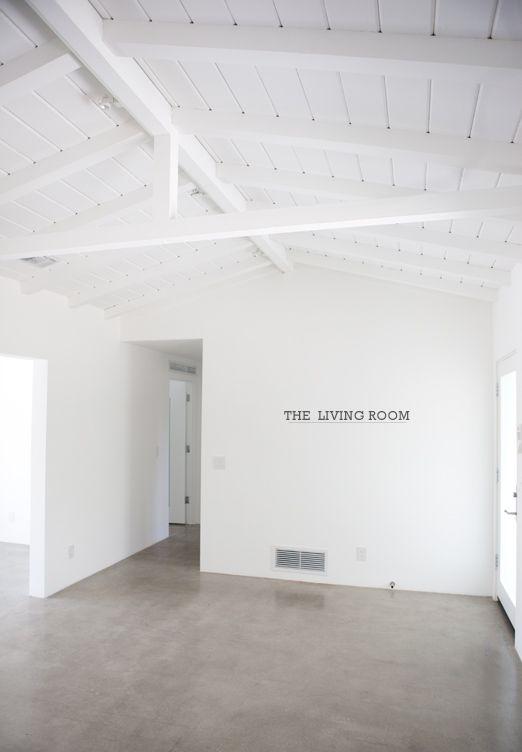 white walls, concrete floors