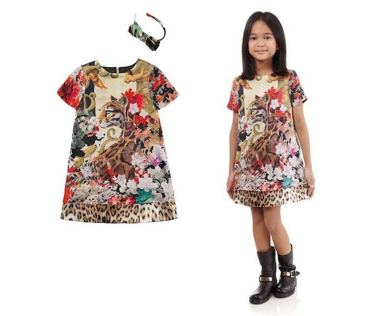 Spot the Tiger in the Cavalli Junior dress with leopard print.