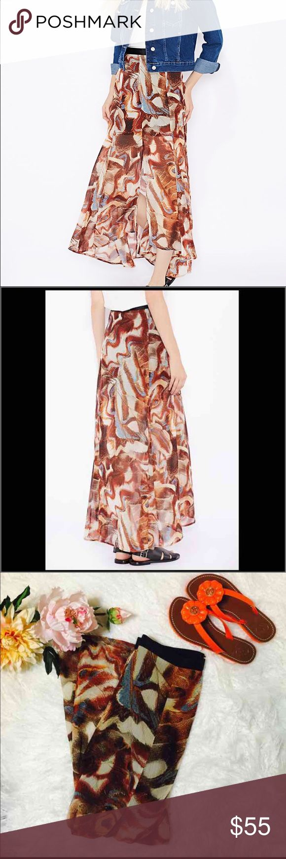 "Top shop Brown Moth Wing Print Maxi Skirt S30-Think boho vibes in this moth print maxi skirt. Cut with a split front and longer hem to the back, this floaty, fluid shape drapes effortlessly. 100% Polyester. Flat across @ waist: 14"", Lenght: 39"". NWT Topshop Skirts Maxi"