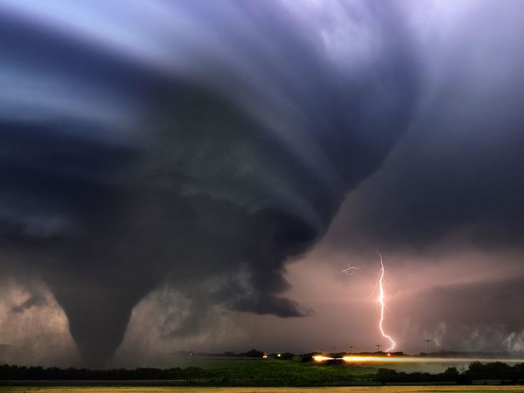 Supercell with tornado and lightning.
