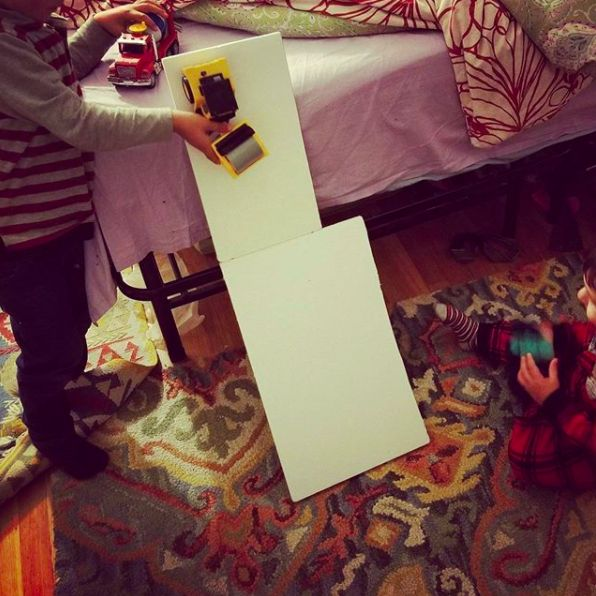 We built some #foamcore home #rollercoasters to practice our #toddlerengineer skills -- will it work? Will it stand up? And what makes the trucks go fastest? The kids love to build it steep and terrifying!