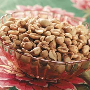 Toffee-Coated Peanuts Recipe A handful is never enough when you serve these mouthwatering nuts, so be sure to make plenty! The sweet toffee coating is enhanced with cinnamon and nutmeg.