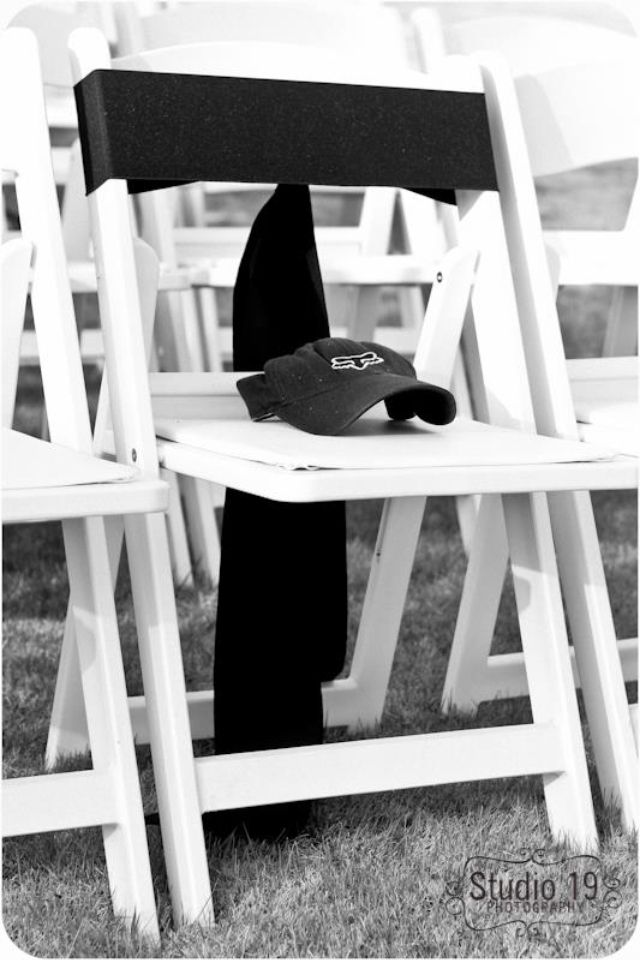 In memory of my brother at my wedding, we left an empty chair between my mom and my dad, tied it with a black sash, and put his hat on it. When my mom walked down the aisle she put a boutonnière is his chair.