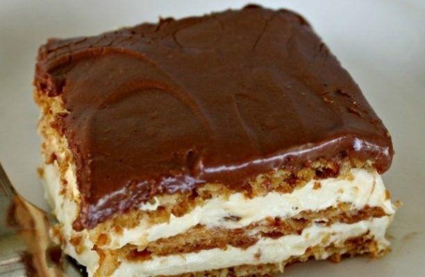 Este GATA în 5 minute și nu necesită coacere! Uite cum se prepară această delicioasă prăjitură cu CIOCOLATĂ!Ingrediente necesare pentru cea mai delicioasă prăjitură cu ciocolată450 g de biscuiti graham200 g crema de vanilie (Poti folosi crema de vanilie la p
