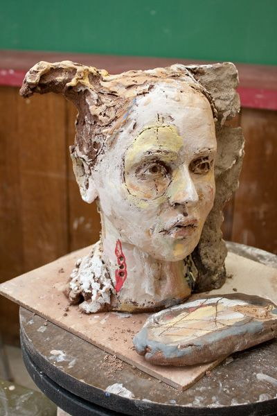 """Debra Fritts finished demo piece. """"Debra shared with participants how she forms her busts and portraits. She also demonstrated how she builds up rich surfaces using oxides, engobes, raw clays, and underglaze.    The way Debra mixes different types of surface treatments, like adding dry clay to wet, was so refreshing. Throughout the workshop, Debra emphasized being """"present"""" with the work."""