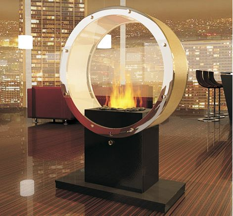 Fireplace? Or dyson bladeless fan? I do actually enjoy the porthole look of this, just not the stand it's on. Would be amazing set into a wall, especially a dividing wall, keeping that window look.
