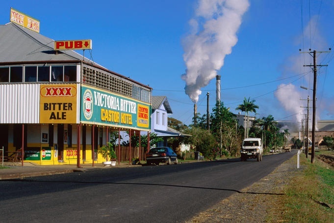 Castor Hotel , cane cutters watering hole, with sugar mill in background, Mourilyan, Innisfail.