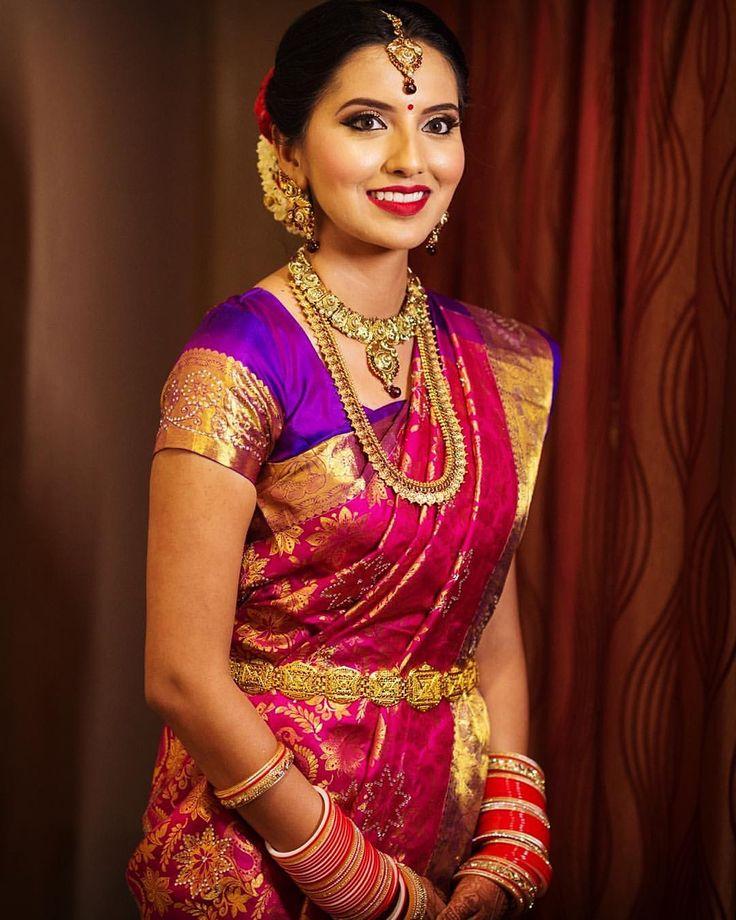 South Indian bride. Gold Indian bridal jewelry.Temple jewelry. Jhumkis. Fuschia pink and purple silk kanchipuram sari.Braid with fresh flowers. Tamil bride. Telugu bride. Kannada bride. Hindu bride. Malayalee bride.Kerala bride.South Indian wedding.