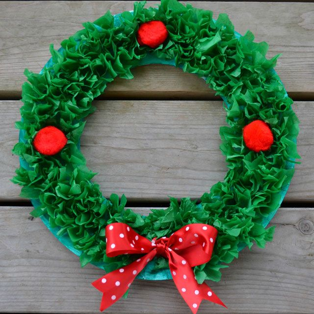 Remember making these as a kid? Cute and easy paper plate wreaths! Made with tissue paper, pom poms and ribbon. Created by @Gina Gab Solórzano Bell... East Coast Mommy with her boys.