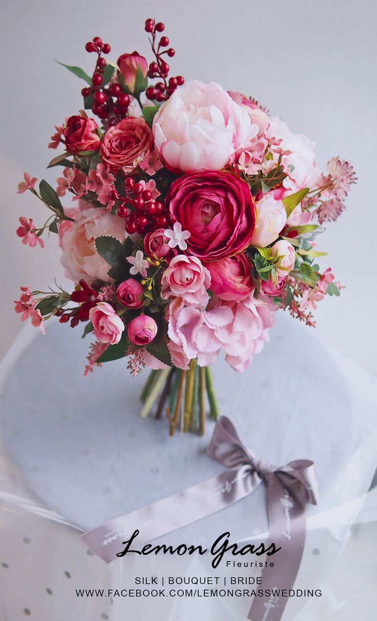 Lillies, roses, peonies oh my! We love this pink inspired bridal bouquet.