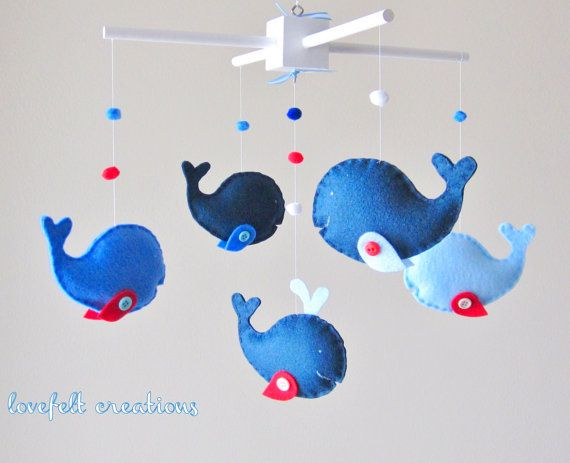 A whale of a crib mobile (from http://www.etsy.com/listing/87258575/baby-mobile-custom-baby-mobile-whale#)