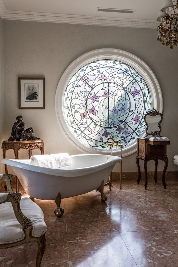 This circular window creates a beautiful focal point in this bathroom.