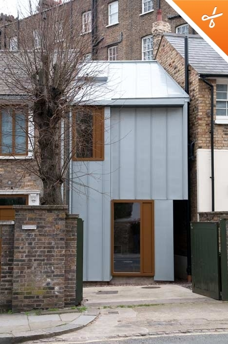 A new fenestration and a zinc-clad extension by architect John Glew into a wedge of land between the house and its neighbour.