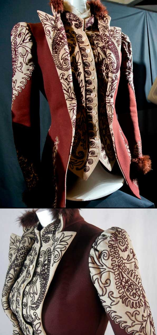 Jacket, ca. 1890s, heavy wool in wine and cream. Tight-fitting, hip-length jacket with stand-up collar. Front attached vest has ornate maroon machine-made embroidery. The same embroidery is found on the shoulder, bottom of sleeves, and on the back. Skirt of the jacket is shaped to fit over a bustle. From the Emily P. Reynolds Historic Costume Collection.