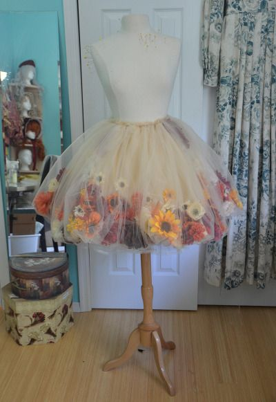 I love this idea of putting flowers under tulle in a skirt. How cute for a Flower Girl!