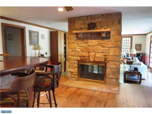 5635 Point Pleasant Pike. Bucks County farmhouse. Tree-lined driveway with apple trees. Hardwood floors, carved fireplace mantel, crown molding, chair rail, 6/6 windows, paneled doors, deep windowsills, 2 sets of pie stairs. Kitchen with center island. Family room with 2-sided fireplace, 2 walls of windows, built-in entertainment cabinet. Second level with 4 bedrooms. Master suite with wood stove, private bath, double vanity, commode, bidet, Whirlpool tub, stall shower.