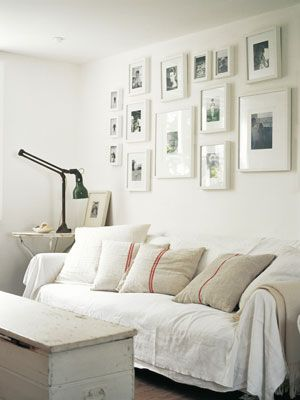 White picture frames grouped together. This idea for my upstairs hallway