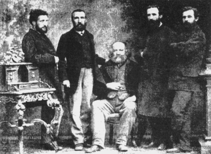 Group photo at the 1869 IWA congress in Basel. From left to right: Monchal, Charles Perron, Mikhail Bakunin, Giuseppe Fanelli and Valerian Mroczkovsky.