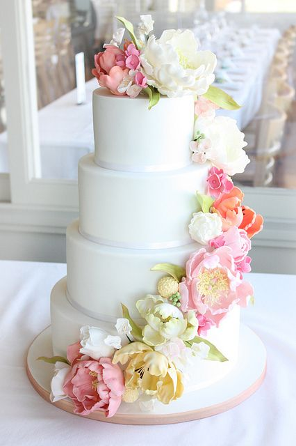 gorgeous white cake with peony decor!