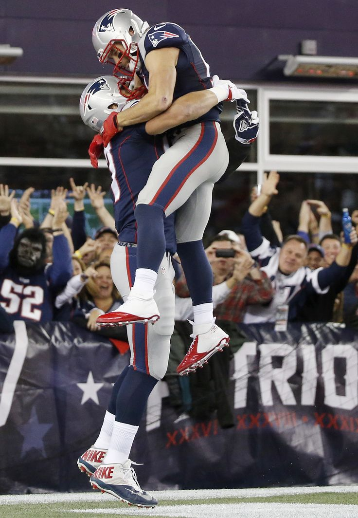 New England Patriots tight end Rob Gronkowski lifts wide receiver Julian Edelman (11) as he celebrates his touchdown in the first half an NFL football game against the Miami Dolphins, Thursday, Oct. 29, 2015, in Foxborough, Mass. (AP Photo/Michael Dwyer)