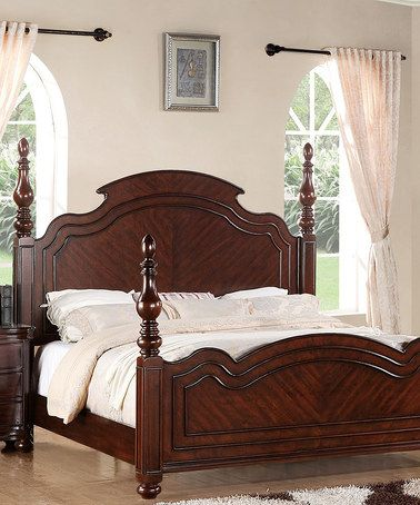 With ornate bed posts, decorative trim and a solid wood construction, this  platform bed exudes timeless appeal.
