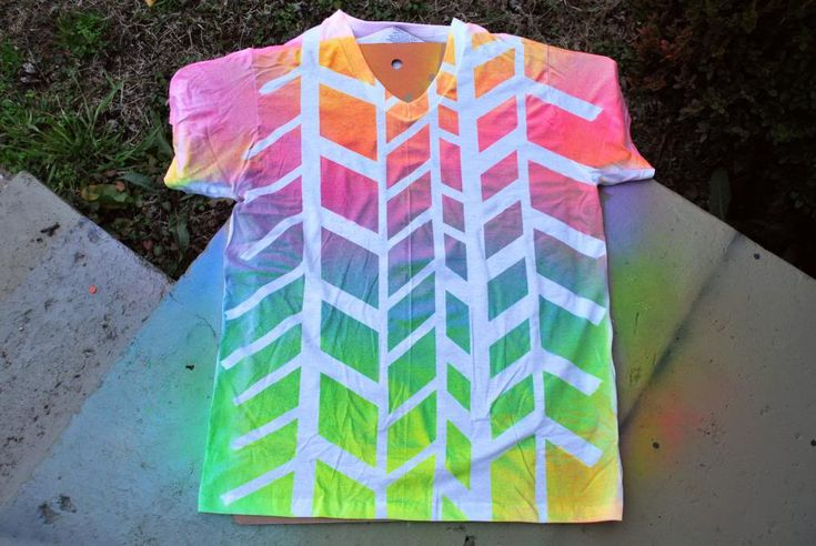 Spray Paint awesome tee shirt = This shirt DIY is super super easy and it doesn't take much time to make! You will need: - A white t-shirt (or any blank light colored one) - Painters tape, we used frog tape - Various spray paint colors