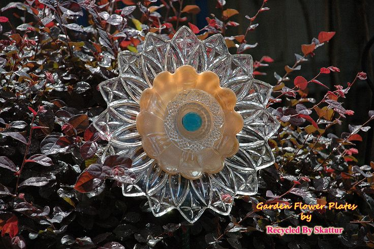 Peach Dahlia Glass Yard Art Garden Flower Plate Sculpture for Garden.  Garden flower plates make beautiful additions to any garden or to flower pot gardens. Most plate flowers are one of a kind. This being a recycle project of mine, my flowers are made by using gently used plates and cut glass pieces, and some pieces may have slight wear marks. I try to add cut glass plates and other glass pieces, to each flower, that makes them natural sun catchers and they really sparkle when the sun hits…