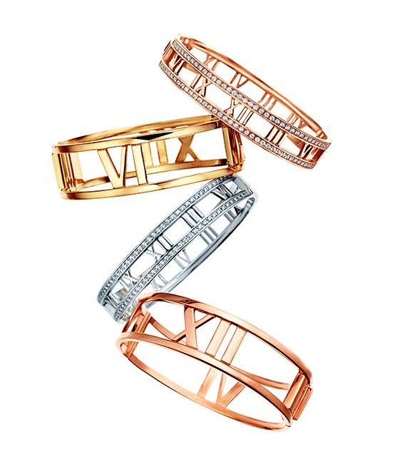 Also new this fall at Tiffany's is the reinterpretation of the Atlas collection. First introduced in 1995, the newest Atlas collection inspired by the Greek god Atlas, features Roman numeral cut outs in bold band rings, bangles and pendant necklaces in 18-karat rose, yellow and white gold.