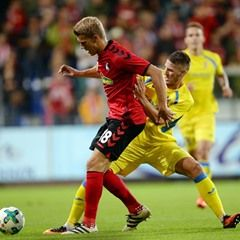 Players vie for the ball during Europa League qualifier - SC Freiburg VS NK Domzale