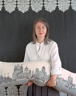 Textile designer, Charlene Mullen, 46, shows off her handiwork and her silver-streaked hair.