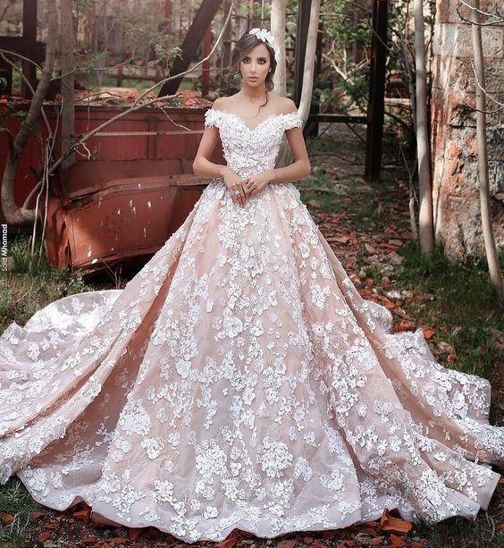 Off-the-shoulder gowns are one of the biggest #bridal trends of the moment! This princess-inspired dress by Sadek Majed Couture is a heart-stoppingly beautiful take on the style.   WedLuxe Magazine   #wedding #weddinginspiration #luxury #dress #fashion