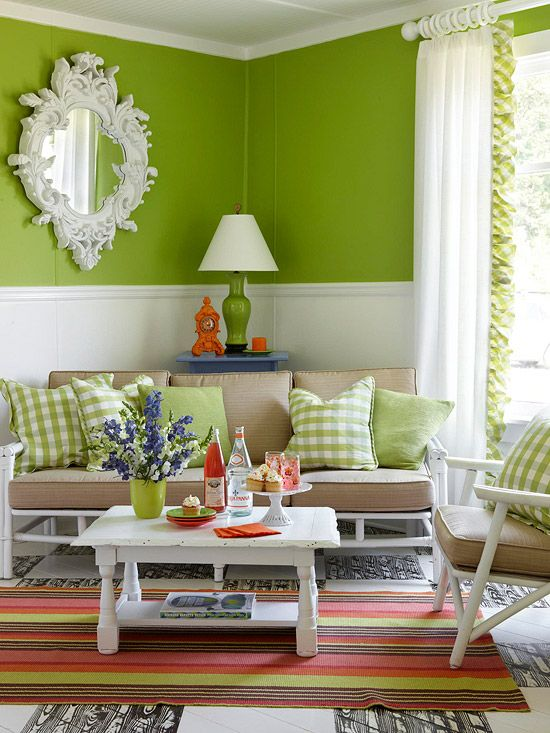 Apple Green  Go bold on your walls with a fresh paint job. Here, bright green paired with green accent pillows creates an inviting space for hanging out with friends and family. Add a colorful rug to the mixture for a funky feel that makes the room fun yet livable.