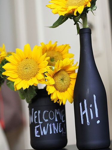 Use chalkboard spray paint to turn old bottles into decorative vases.