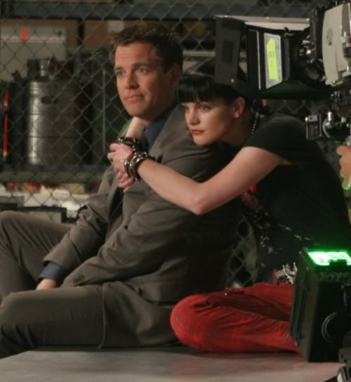 Michael Weatherly and Paulley Perette on the set of NCIS