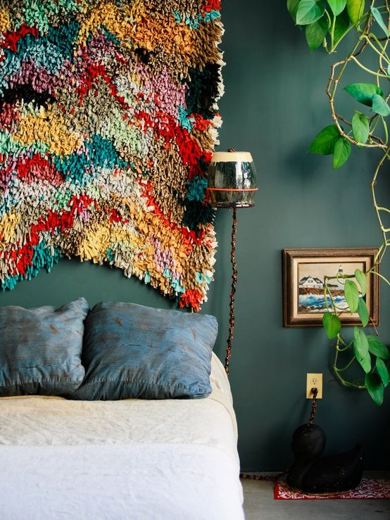 I love all of this. The paint colour, the wall hanging, the giant indoor plant. and the crocheted cover on cord for lamp!