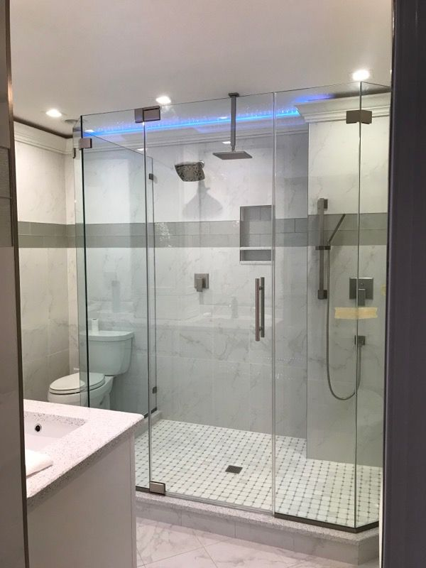 Custom Configuration On A Frameless Shower Enclosure With Glass To