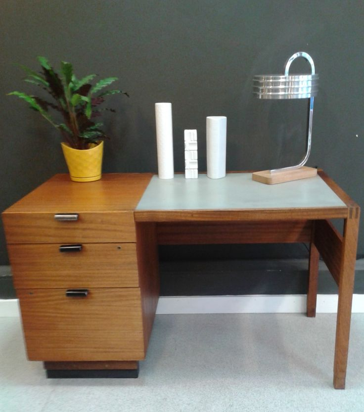 a fantastic small industrial desk with a pale bluegrey laminate and wood surface