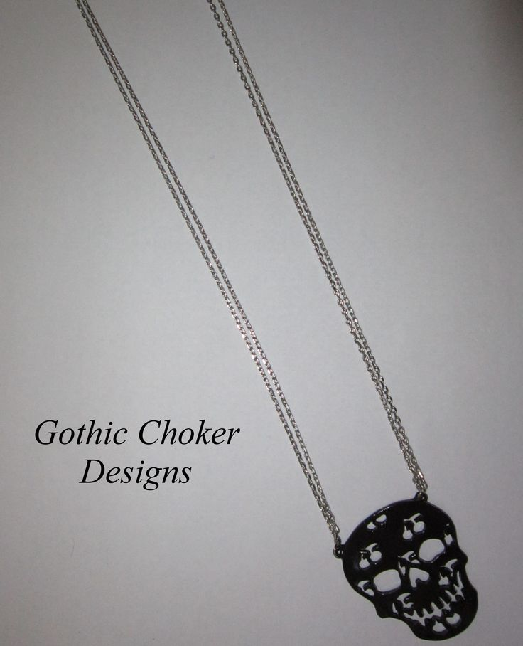 Black skull on double thin chain necklace. R80 approx $8.  Purchase here: https://hellopretty.co.za/gothic-choker-designs/black-skull-necklace