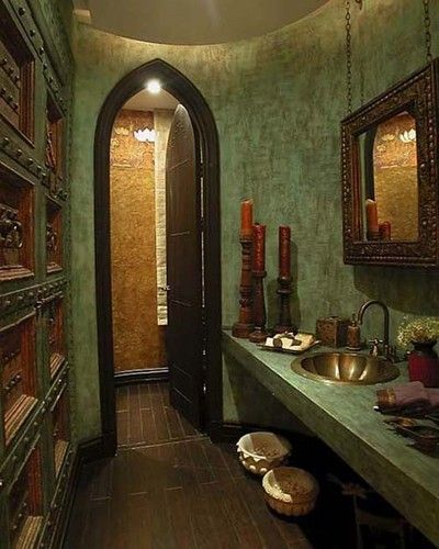 Moroccan style bathroom.  I love the rich green with the wood floor.
