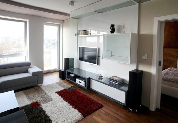 Interior Modern Apartment Design: Spot Of Black Vase Modern Apartment Style With Combination Wooden Glass Television And Media Storage Also Pale Color Sofa Mix White Cream Reddish Rug