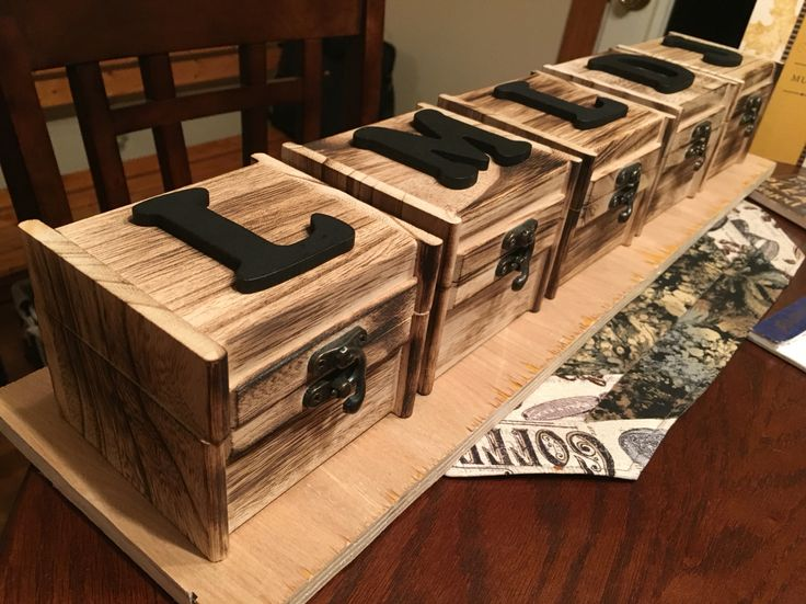 Our bridesmaids gifts for our rustic wedding!  We took a regular wooden box with a rustic latch purchased at Michaels and burned it with a blow torch!