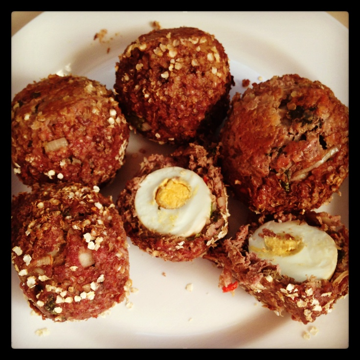 Kangaroo Baked Scotch Eggs **A healthy high protein take on a British classic** Kangaroo mince, garlic, onion, chili, cumin, coriander, Worcester sauce & seasoning - covering hard boiled egg - rolled in Quinoa flakes - sealed in a pan then baked for 20 mins. Serve it with spicy tomato sauce ❤