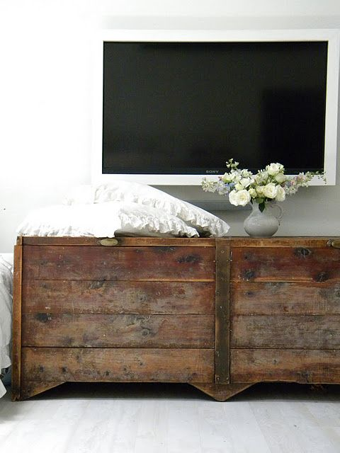 Look at this combo! Reclaimed wood and modern TV. Its so amazing!