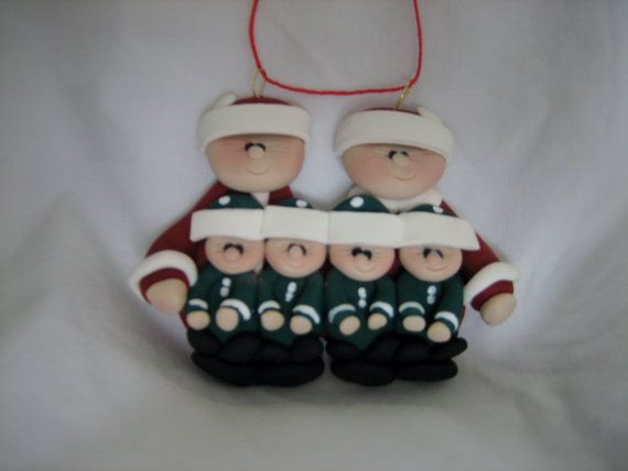 Santa and Mrs. Claus family with 4 little elves. This ornament would be ideal for a family of 2 adults with 4 children, or grandparents with