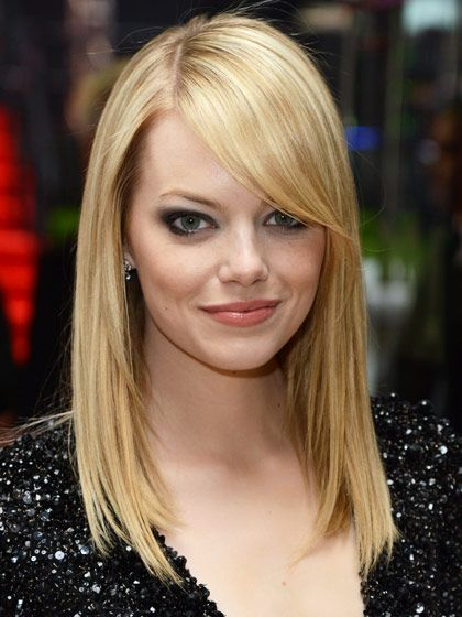 """LONG AND SIDE-SWEPT  These sleek bangs are flattering for every face shape. """"This look is sexy and mysterious,"""" says Garren of the Garren New York salon. Ask your stylist to cut long bangs at an angle, so they blend in with the rest of your hair."""