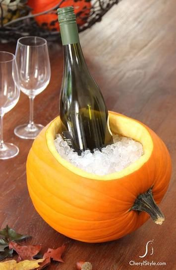 20 DIY Thanksgiving crafts to decorate your table - diy ice filled pumpkin as champagne + wine chiller