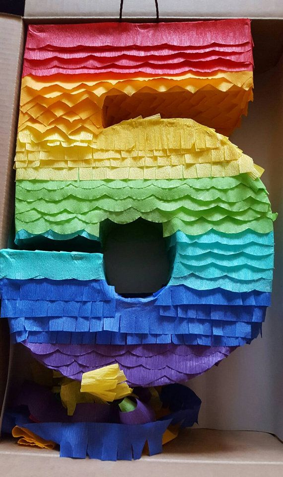 This is one of a kind Rainbow number Pinata Measures : 22 by 14 approximately Safe for everyone and easy to fill.  Available pull string and traditional hit pinata.