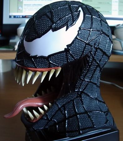 Master Replicas is proud to present the Venom Mask Scaled Replica, this resin reproduction accurately replicates the alien symbiote in all of his rage-filled glory.  The Venom Mask Scaled Replica features all of the attention to authentic detail you've come to expect from Master Replicas.  Stands over 7 inches tall & includes custom Spider-Man 3 display stand.  Made from high-quality molded plastics and resin, authentically replicating Venom's on-screen textures.  Certificate of Authenticity