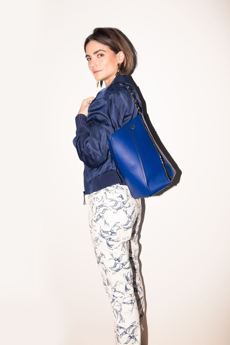 Our Guide to Styling G-Star RAW Elwood X25 Collection:How I finally got out of my blue denim comfort zone (& what Pharrell has to do with it). In collaboration with G-Star Raw.  ----- Chinoiserie printed denim, Monochrome long-sleeve knit and bomber combo, low stacked mules, blue tote bag.| Coveteur.com