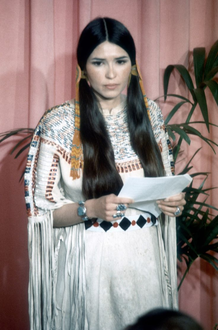 Sacheen Littlefeather holds a written statement from actor Marlon Brando refusing his Best Actor Oscar on stage at the Academy Awards on March 27, 1973 in Los Angeles, California. Description from nyooztrend.com. I searched for this on bing.com/images